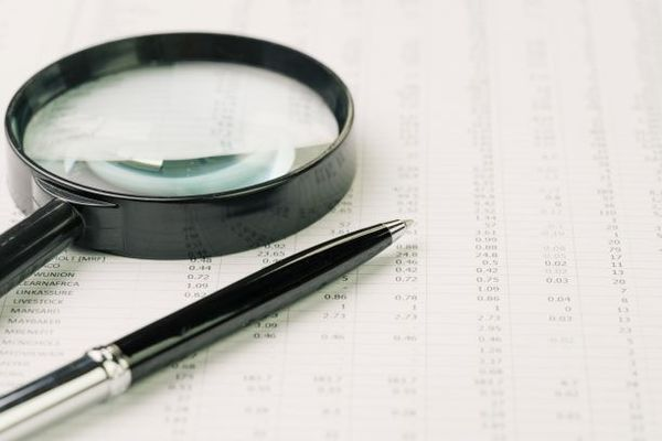 Magnifying glass and pen.
