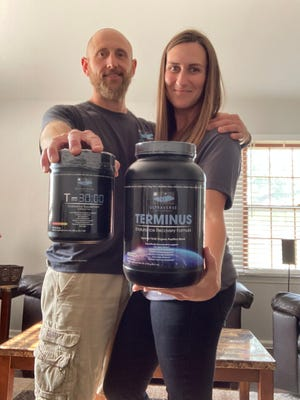 Chase and Casey Hammond hold containers of nutritional supplements offered by Ultraverse Supplements, a web-based business they officially launched late last year.