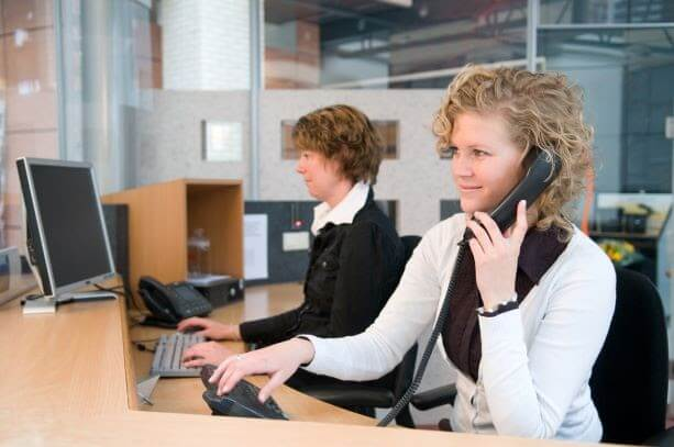 Two women at a front desk area