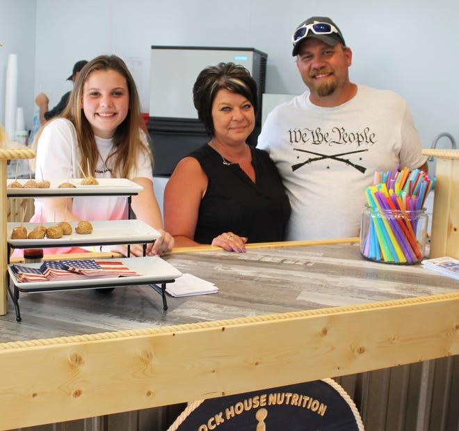 Kelli and Tim Martin, co-owners of Dock House Nutrition in Quincy, with their daughter Ava.