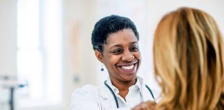 photo of doctor talking with female patient