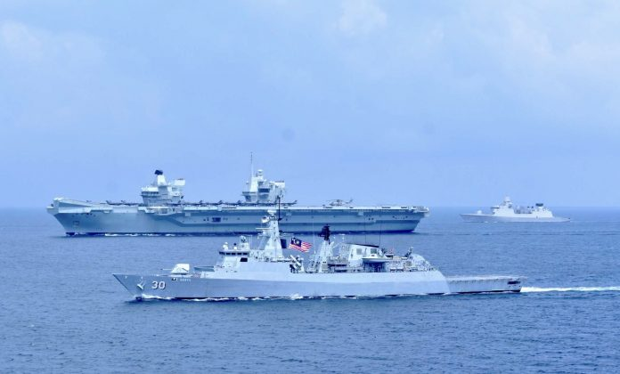 The British airline HMS Queen Elizabeth now lies on the edge of the South China Sea
