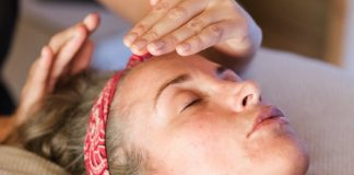 Coping: Curious reporter is receiving a Reiki treatment and wants to tell you about it