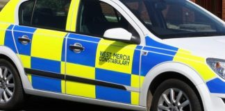 Paramedics treat a woman injured in an accident in Kempsey, Worcestershire