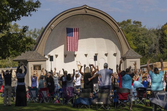 People listen to speakers at the Chiropractic Society Health Freedom revival Sunday, Sept. 19,...