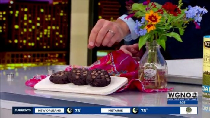 FUELED Wellness + Nutrition |  Hank + Molly in the kitchen with double dark chocolate chip cookies