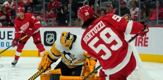 Pittsburgh Penguins goalkeeper Casey DeSmith stops a shot by Tyler Bertuzzi on the left wing of the Detroit Red Wings during the second phase of a preseason game on Thursday, October 7, 2021, in Detroit.