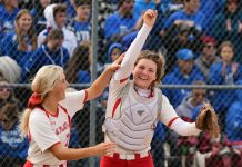 La Plata catcher Claire Coy celebrates with her sister Olivia Coy after reaching the final of Saturday's quarter-final against Atlanta.