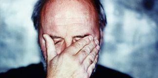 older adult man having migraine, headache