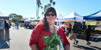 """At participating farmers markets, low-income shoppers using their EBT cards get an extra $15 to spend on fruits and vegetables, thanks to a federal nutrition incentive program. """"Being able to get organic vegetables is amazing,"""" says KC Ochoa."""